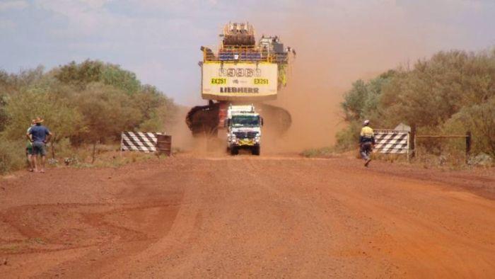 It Took Six Trucks To Move This Mining Excavator (4 pics)