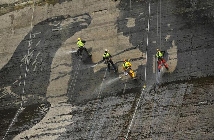 Workers Used Pressure Washers To Create This Stunning Mural On A Polish Dam (6 pics)