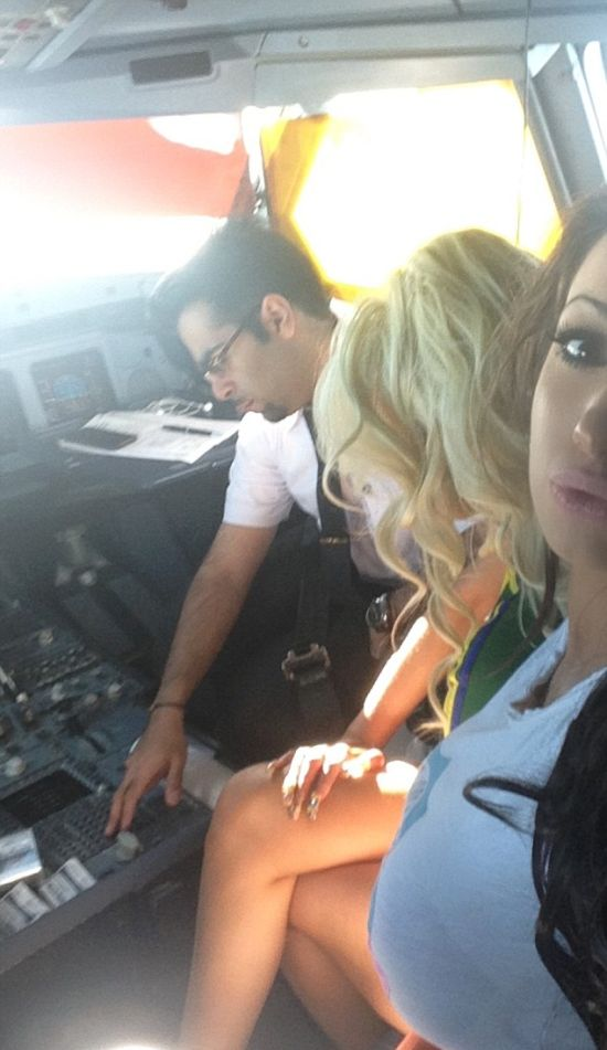 Naughty Pilot Flying From Heathrow To New York Let's Ex-Porn Star In The Cockpit (3 pics)