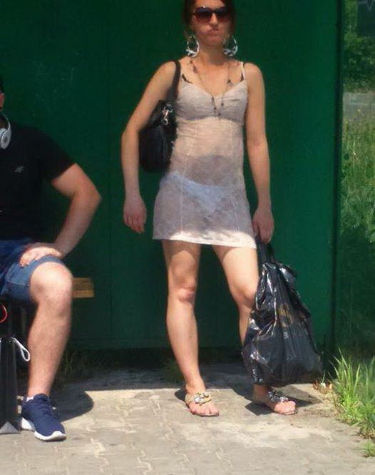 Girl Walks The Street Wearing Next To Nothing (2 pics)