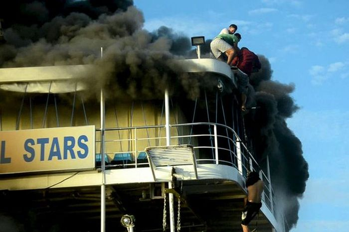 Terrified Passenger Jumps Out Of Burning Ferry  (3 pics + video)