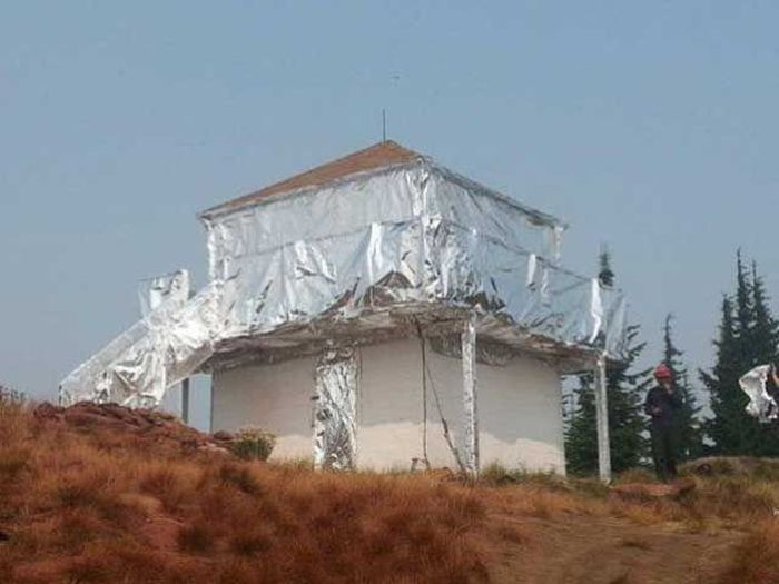 Buildings Wrapped In Tin Foil To Protect Them From Wildfires (3 pics)