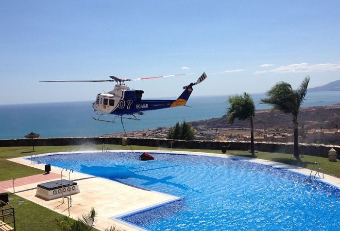 Firefighting Helicopter Refills A Basket With Water From A Swimming Pool (8 pics)