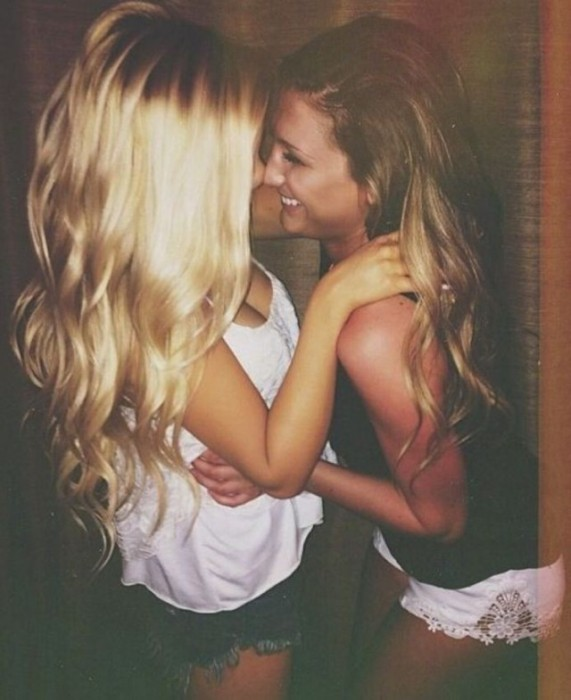 Two Pretty Girls Kissing