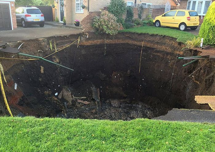 Enormous Sinkhole Swallows A Section Of The Street (3 pics)