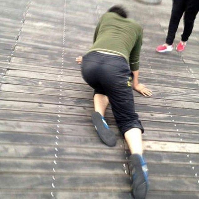Chinese Company Forces Staff To Crawl When They Don't Meet Sales Goals (5 pics)