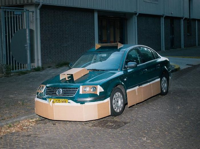 One Man Is Pimping Out People's Cars With Cardboard (8 pics)