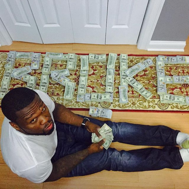50 Cent Sure Doesn't Look Like He's Bankrupt (2 pics + video)