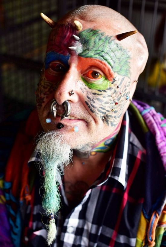 Animal Lover Chops Off His Ears So He Can Look Like A Parrot (8 pics)