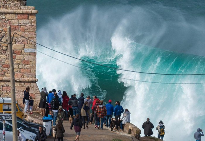 People Watch In Awe As Surfers Ride 100 Foot Waves (7 pics)