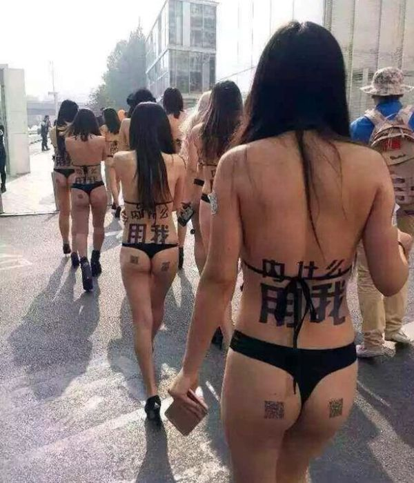Near Naked Models Walk The Streets Of Beijing With QR Codes On Their Butts (4 pics)