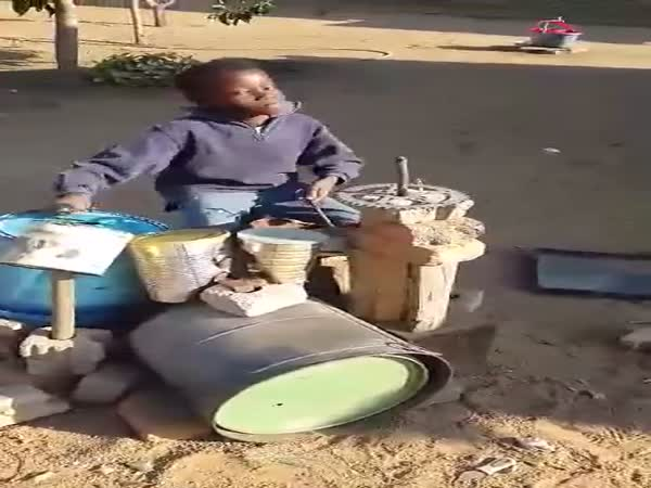 Boy Playing On Makeshift Drums