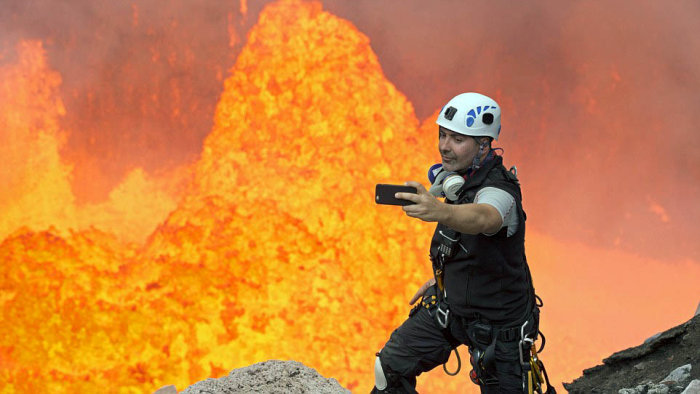 Brave Man Takes A Selfie On An Active Volcano (4 pics)