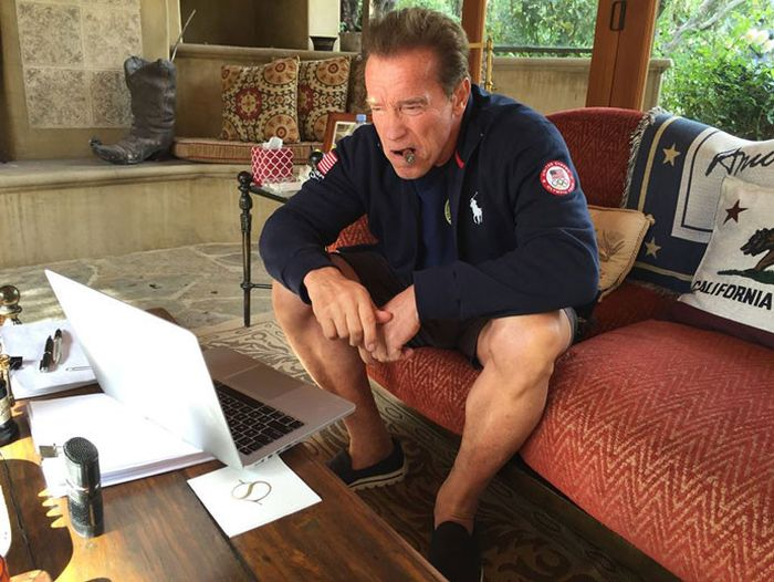 Arnold Schwarzenegger Gets Cozy Next To A Statue Of Himself