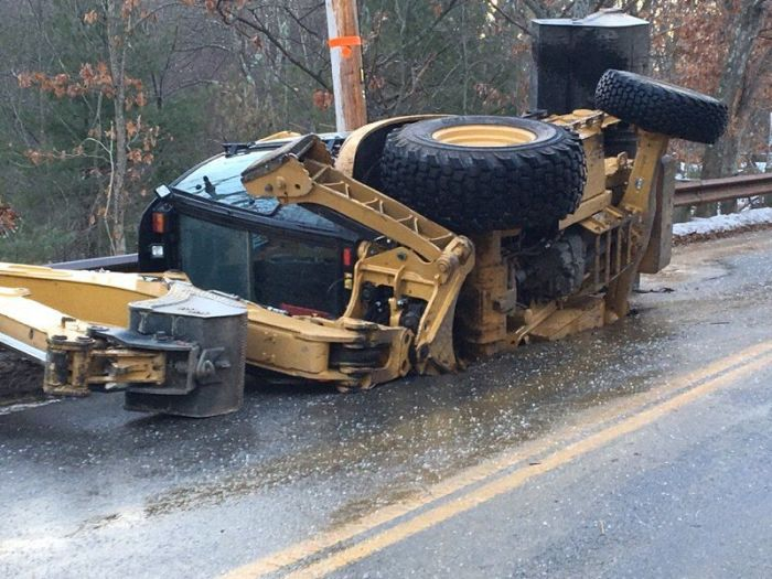 An Excavator Almost Got Swallowed Up By This Hole In The Road (3 pics)