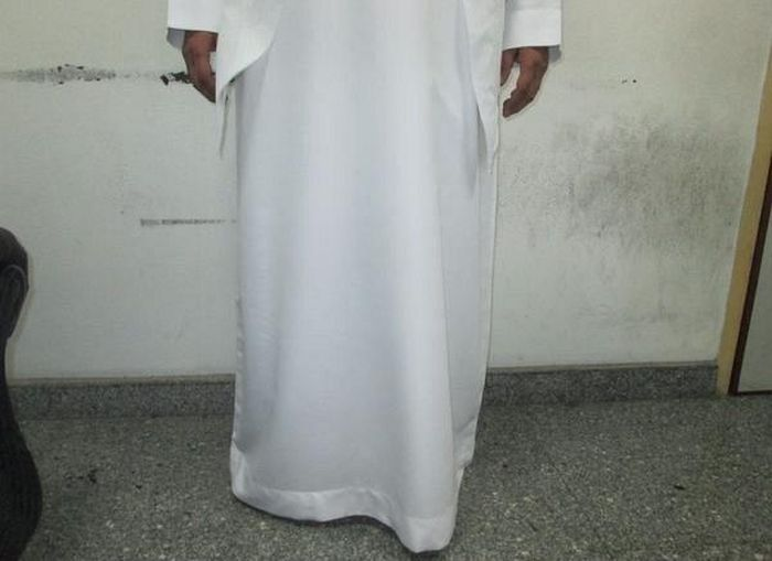 Saudi Man Gets Busted While Trying To Smuggle Booze In His Pants (4 pics)