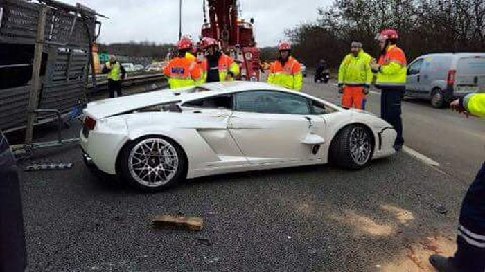 Transporter Carrying 9 Supercars Overturns On The Road (9 pics)