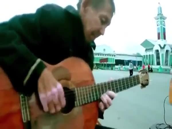 Homeless Man Plays Guitar
