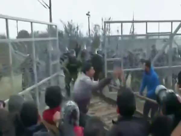Migrants Use Battering Ram On Greece Macedonia Border Fence Macedonia Police Fire Tear Gas