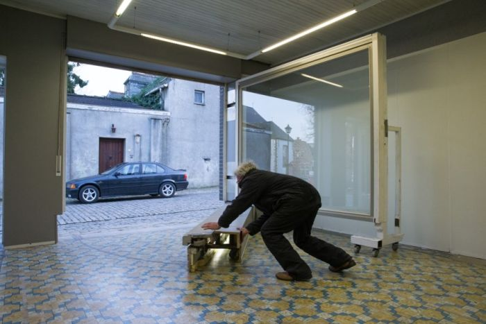Belgian Man Builds A Secret Garage Door (13 pics)