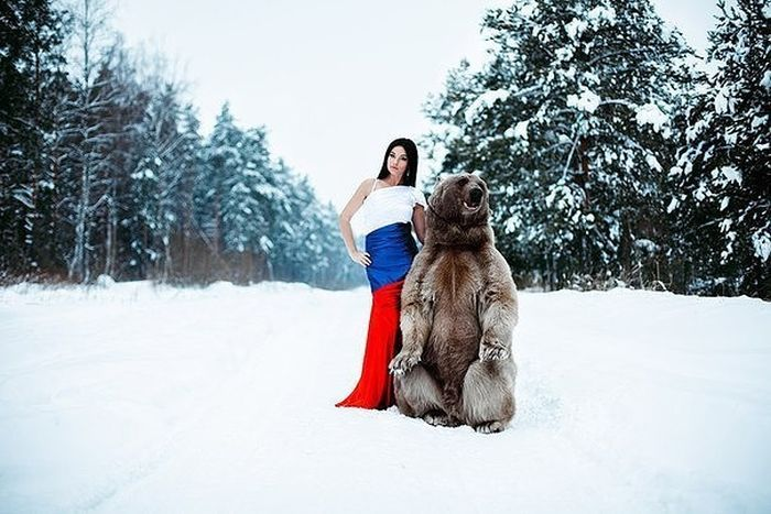 Beautiful Model Poses For A Snowy Photo Shoot With A Friendly Bear (7 pics)