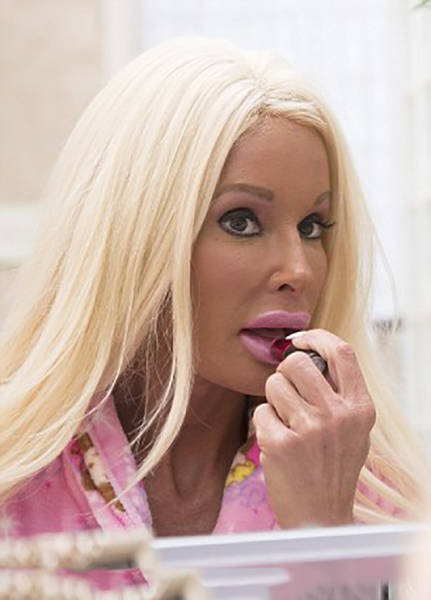 A 42 Year Old Mom Spent $500,000 To Make Herself Look Like Barbie (33 pics)