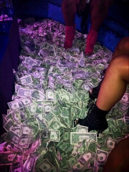 Girls striping for money