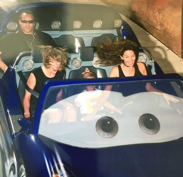 Taylor Swift's Bodyguard Is Not Impressed By Disneyland (2 pics)