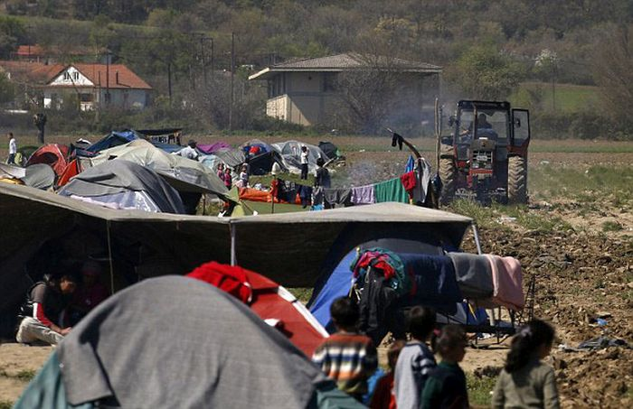 Greek Farmer Runs Down The Tents Of Syrian Migrants With His Tractor (9 pics)