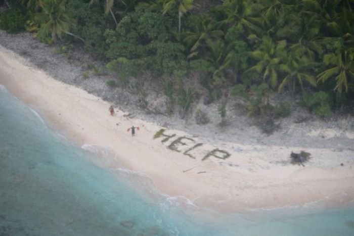 Castaways Get Rescued After Making A Help Sign In The Sand (4 pics)