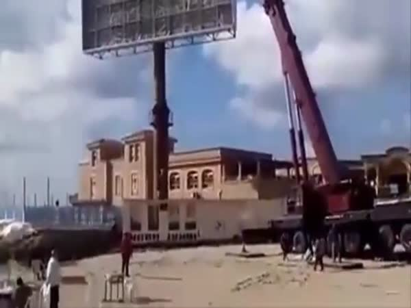 Disgruntled Worker Flips A Crane With A Bulldozer