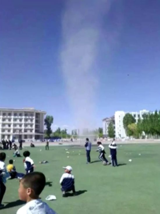 Chinese Boy Gets Sucked Up By Dust Devil Twister (4 pics + video)