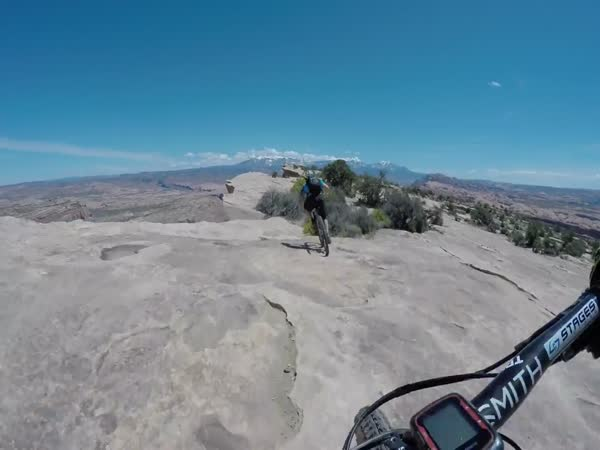 Fearless Mountian Bike Riders On The Edge Of A 400 Foot Cliff