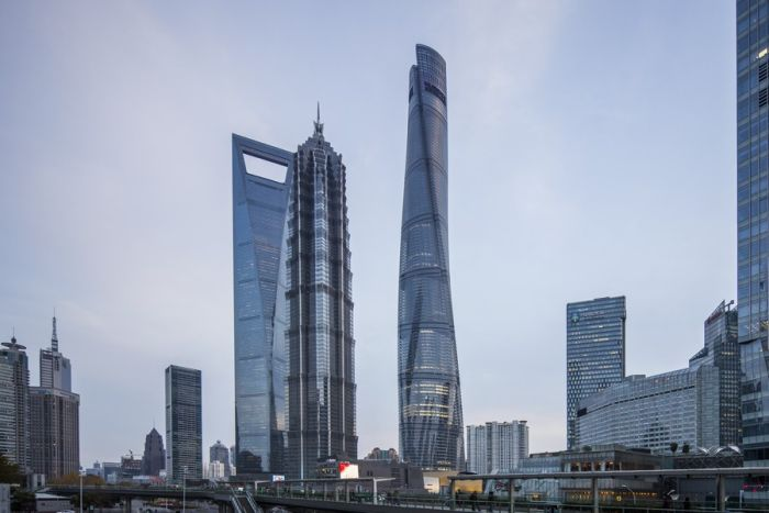 Tesla Driver Injured After Window Falls From The Shanghai Tower (4 pics)