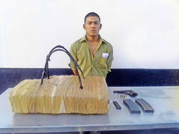 Man Tries And Fails To Disguise Drugs As A Backpack While Crossing The Border (2 pics)