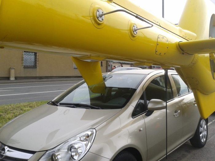 Helicopter Lands Directly In A Car's Windshield (3 pics)