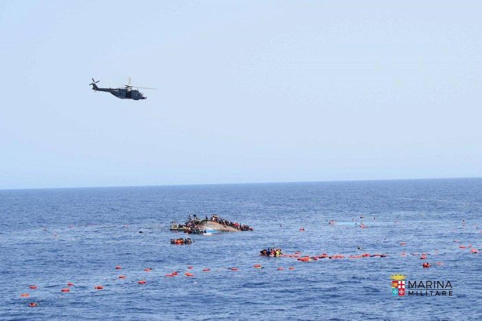 Italian Navy Rescues Migrants After Their Boat Reaches A Tipping Point (8 pics)