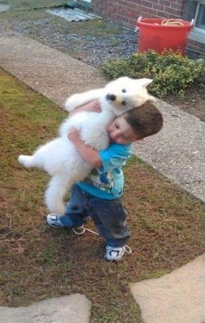 This Boy And His Dog Are Much Bigger Now That 15 Years Have Passed (2 pics)