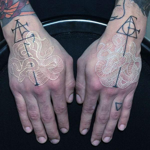 Mirko Sata Creates The Coolest Black And White Snake Tattoos (9 pics)