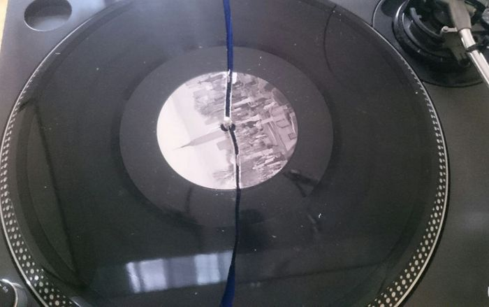 Russian Mail Carrier Folds Vinyl Record In Half (2 pics)