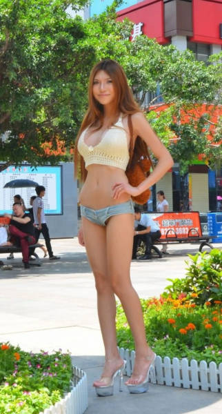Chinese Woman Lands Modeling Jobs By Walking Around Half Naked (27 pics)