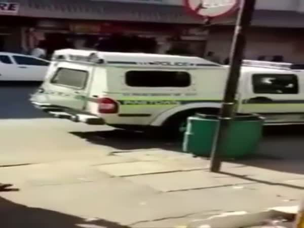 Suspects Squeeze Out Of A Police Van While The Cops Stop For Lunch