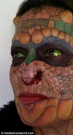 Former Bank Employee Modifies Their Body To Look More Like A Dragon (11 pics)