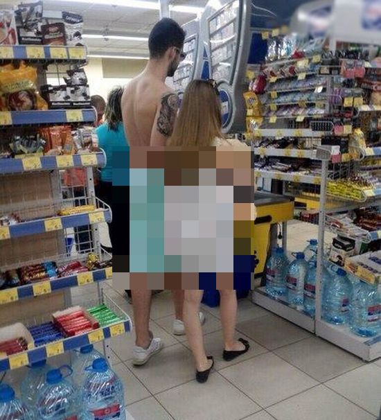 Couple Shops While Dressed In Odd Clothing (2 pics)