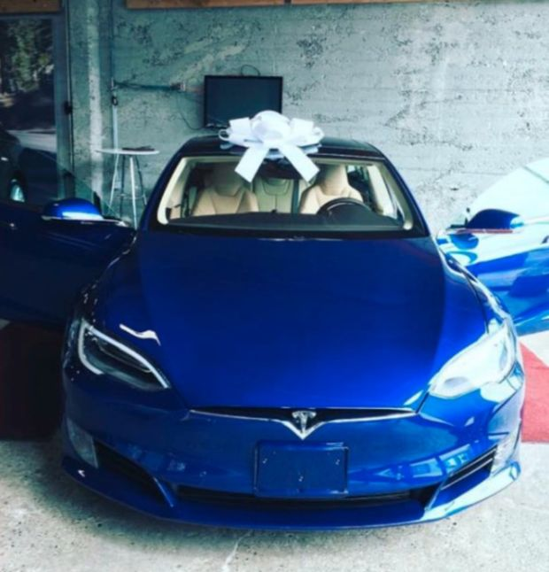 Employees Buy A Tesla Model S For Their Boss To Say Thanks (5 pics)