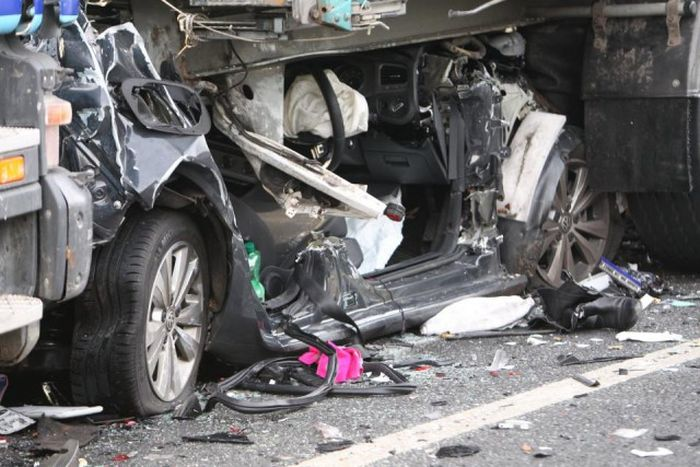 Driver Somehow Survives After Being Crushed Between Two Trucks (5 pics)
