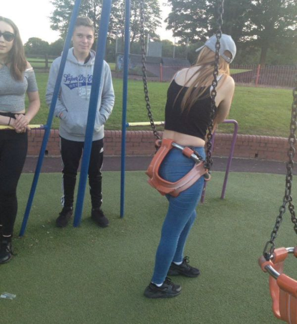 Apparently This Girl Is A Little Too Old For The Swing (2 pics)