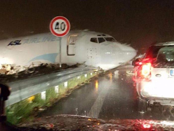 Cargo Plane Overshoots Runway And Crashes Into A Road In Italy (3 pics)
