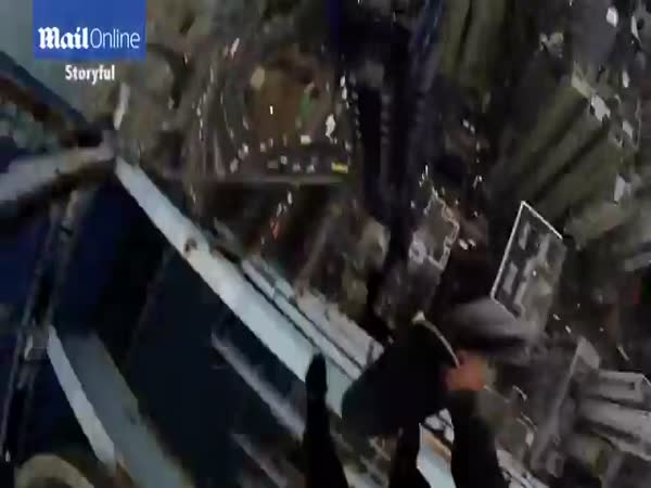 Skateboarder Balances His Deck On The Edge Of A Hong Kong Skyscraper