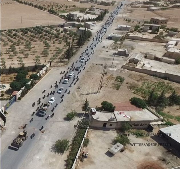 Hundreds Of Isis Cowards Flee Syrian Stronghold Using Civilians As Human Shields To Avoid Being Hit By Coalition Airstrikes (3 pics)